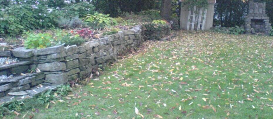 rebuilt retaining wall Manor Park - Before